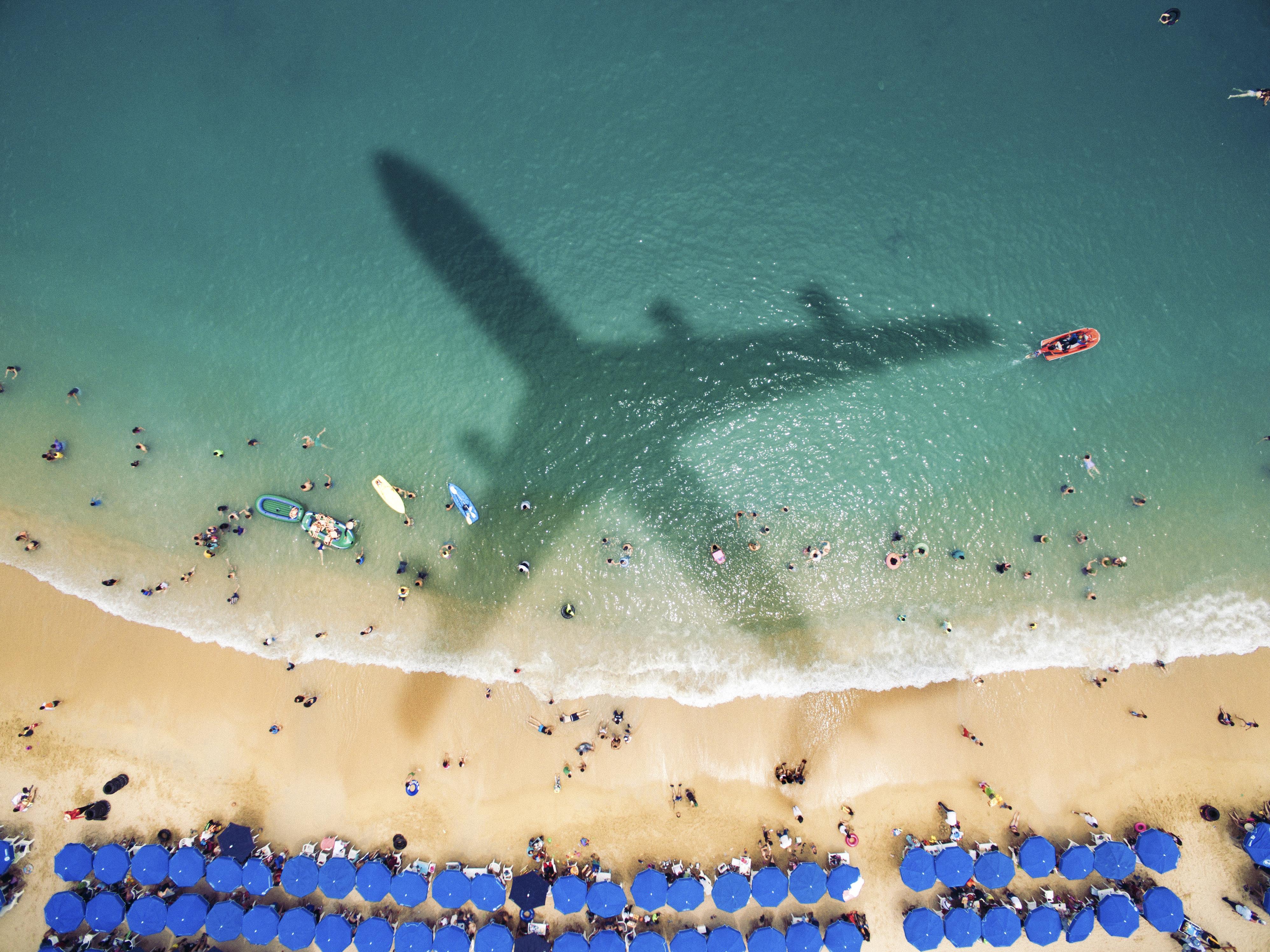 Airplane over latin american beach