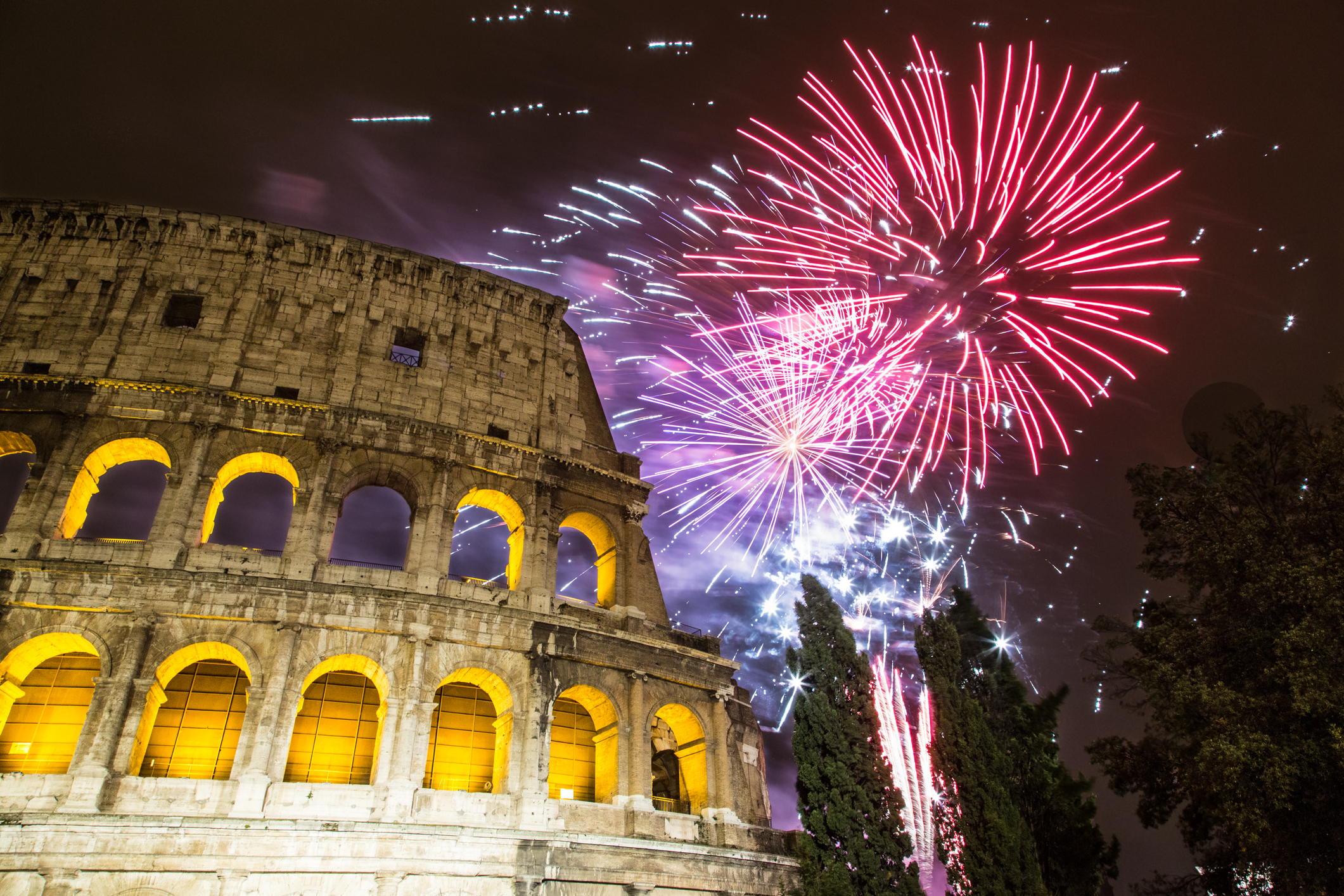 New Year's fireworks in the sky by the Colosseum in Rome : Stock Photo