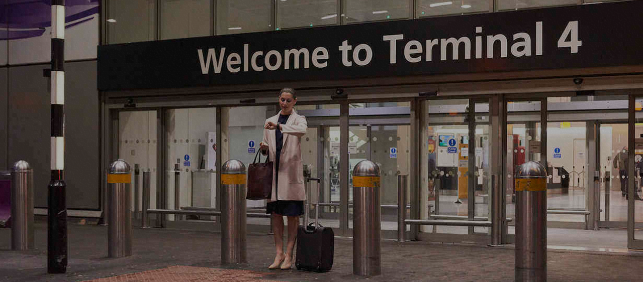 lady waiting outside the terminal at the airport