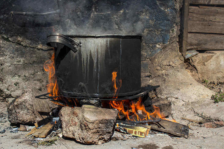 A lot of Caribbean food is cooked on the fire in pots such as this one.